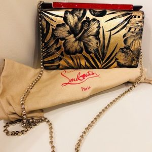Christian Louboutin patent hibiscus clutch bag